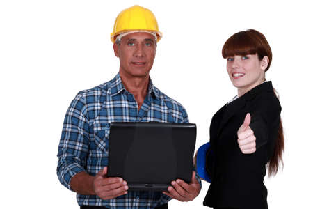 businesswoman and craftsman posing together Stock Photo - 16842124