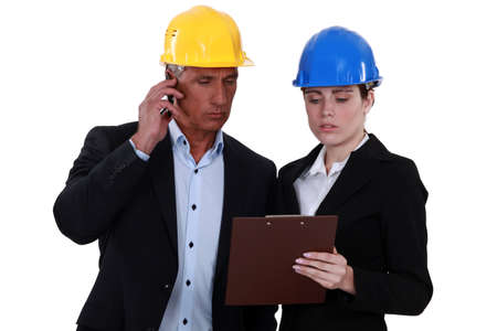 40 45: Architect and female assistant Stock Photo