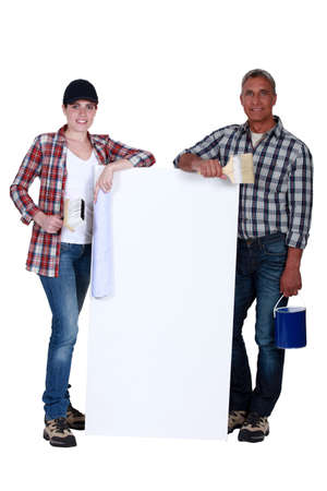 two painters holding a white ad board Stock Photo - 16842030