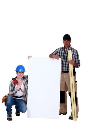 Plumber and carpenter holding white board Stock Photo - 16890048