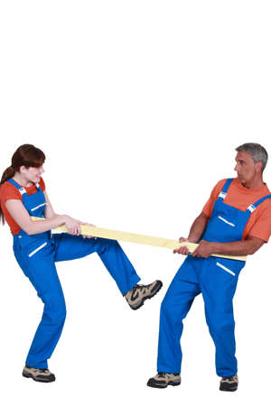 jumpsuit: Couple holding plank of wood