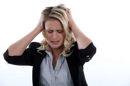 young blonde having migraine Stock Photo - 16842011