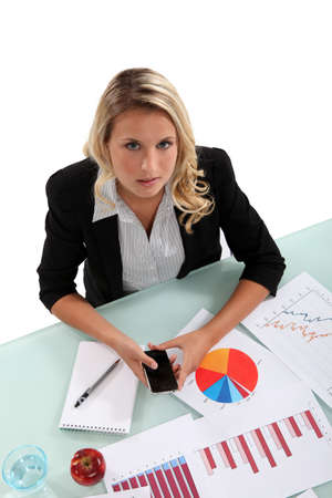 Woman examining charts Stock Photo - 16842013