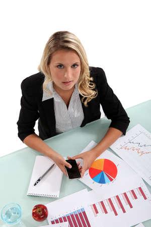 Woman examining charts Stock Photo - 16842013