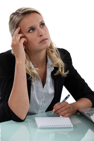 blonde secretary lost in thoughts Stock Photo - 16841940