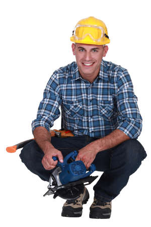 Smiling man with a circular saw Stock Photo - 16842002