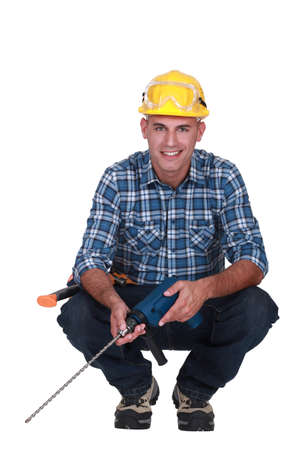 Workman with a masonry drill Stock Photo - 16842055