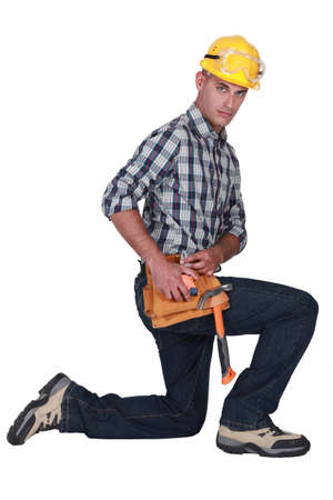 Builder kneeling Stock Photo - 16842071
