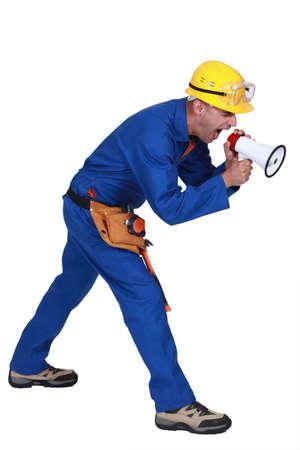 Builder screaming into megaphone Stock Photo - 16888752