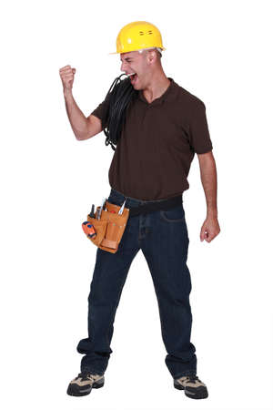 jubilate: craftsman raising his fist and laughing