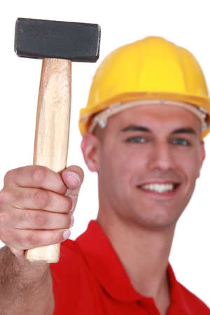 Manual worker proudly showing off hammer Stock Photo - 16841993