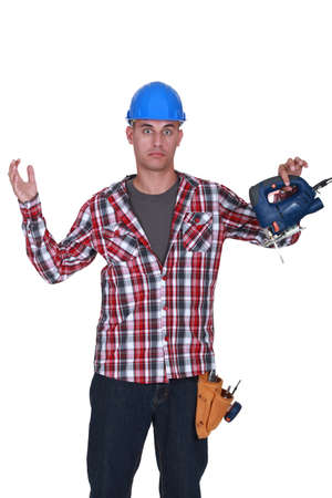 alarmed: Alarmed man with a saw