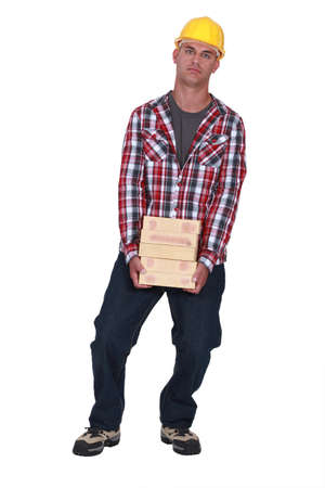 Man carrying pile of bricks Stock Photo - 16890051
