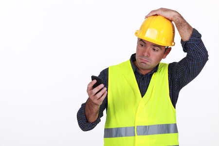 workman with fluorescent safety jacket looks puzzled Stock Photo - 16841923