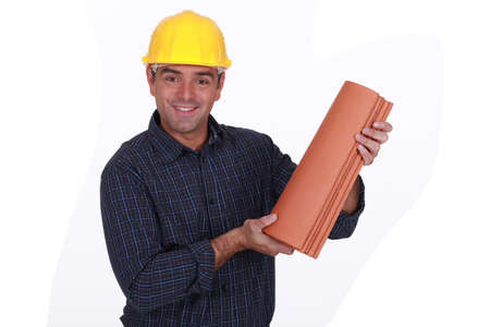 Roofer holding tiles Stock Photo - 16842063