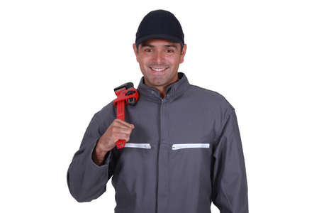 Cheerful plumber resting wrench on shoulder Stock Photo - 16842070