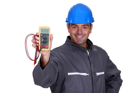 voltmeter: happy electrician showing multimeter Stock Photo