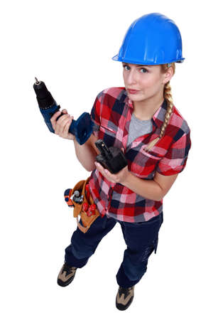 sceptic: Tradeswoman holding a battery-powered power tool