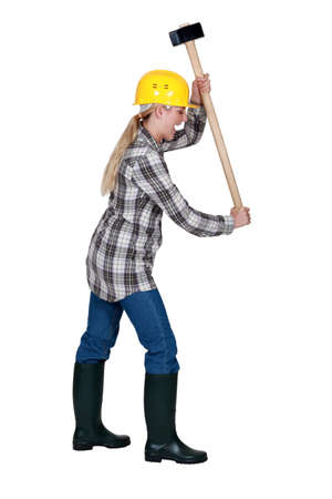 eradicate: Angry tradeswoman about to smash an invisible object