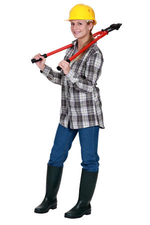 Tradeswoman carrying a pair of large clippers around her neck photo