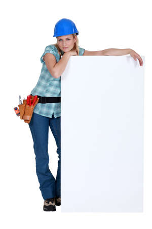 Female worker with a blank board Stock Photo - 16890197