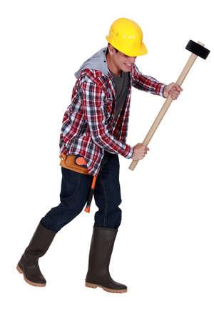 laborer holding hammer Stock Photo - 16890049