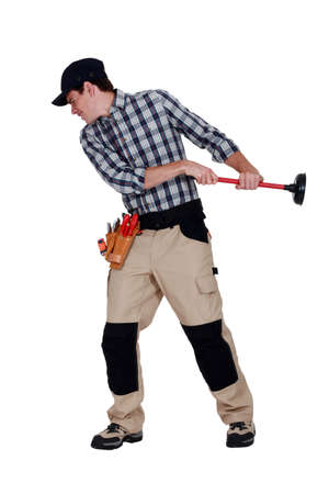 craftsman pulling a plunger Stock Photo - 16889980