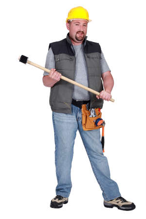 Full-length portrait of a tradesman holding a mallet photo