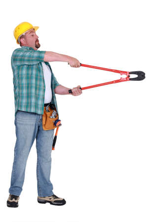 Man using bolt cutter Stock Photo - 16889574