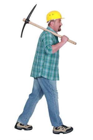 mattock: Man holding pick axe