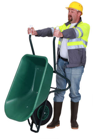 Tradesman emptying a wheelbarrow photo