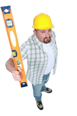 Builder brandishing a spirit level photo