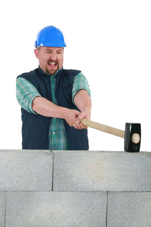 Man destroying wall with sledge-hammer Stock Photo - 16842026