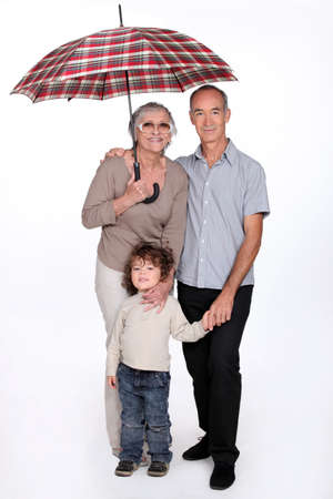 65 70 years: Grandparents posing with their grandchild