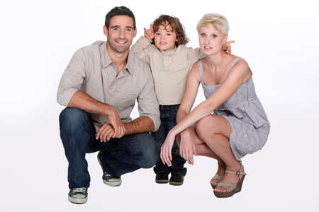 Studio shot of parents and their young son Stock Photo - 16841938