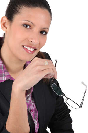brunet woman holding reading glasses Stock Photo - 16841922
