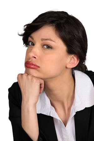 glum: Glum looking businesswoman