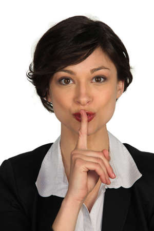 Businesswoman quiet gesture photo