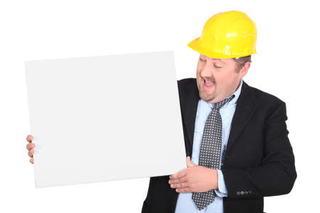 man in suit wearing yellow hard hat with canvas Stock Photo - 16900516