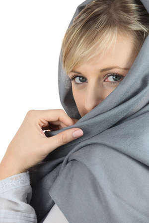 hushed: Woman with grey shawl