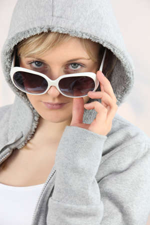 Girl with sunglasses and hoodie Stock Photo - 16901823
