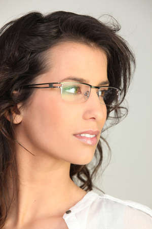 appealing attractive: brunette wearing glasses