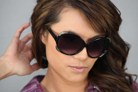 Fashionable woman with sunglasses photo