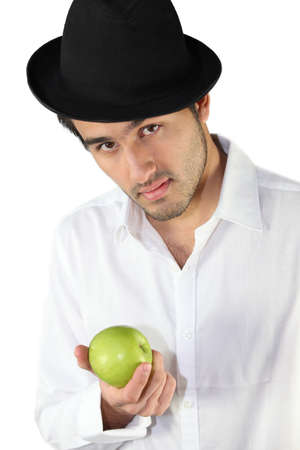 Man wearing hat and holding apple Stock Photo - 16900909