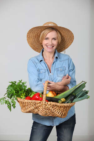 Woman with a vegetable basket photo