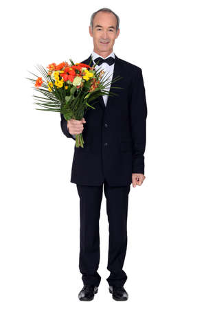 55 years old: Man with a bouquet of flowers