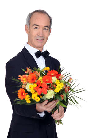Man with bouquet of flowers Stock Photo - 16900521