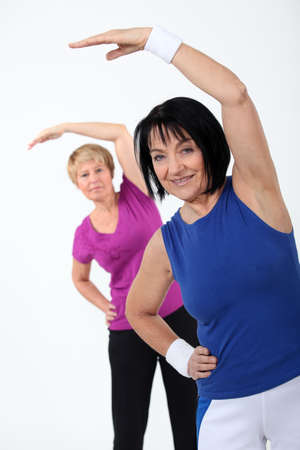 tiring: two senior women doing fitness Stock Photo