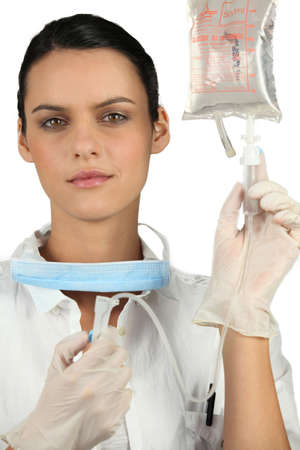 gloves nurse: Nurse preparing IV drip Stock Photo
