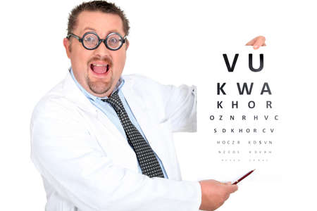 visual perception: ophthalmologist making an eye examination with a Snellen chart
